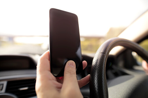 Holding a cellphone while driving